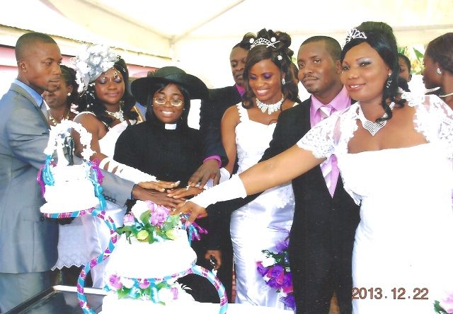 Rev Joyce Frimpong, Middle helping them cut the cake, from Right is Mr &Mrs. Agyare, Francis &Monica Mensah in Middle, left, Francis &Mary Mensah