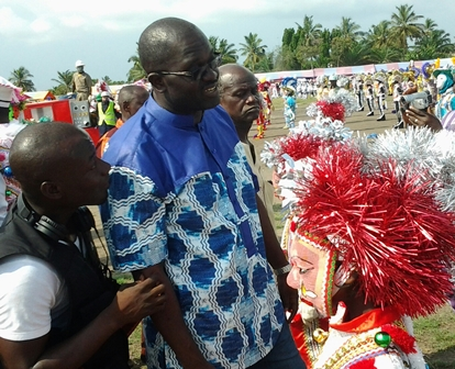 nana ofori inspects masqueraders