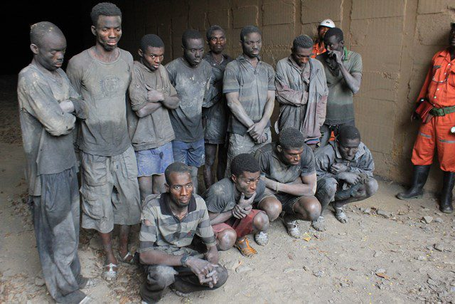 The illegal miners standing infron of the Obuasi Cote Dor Mine