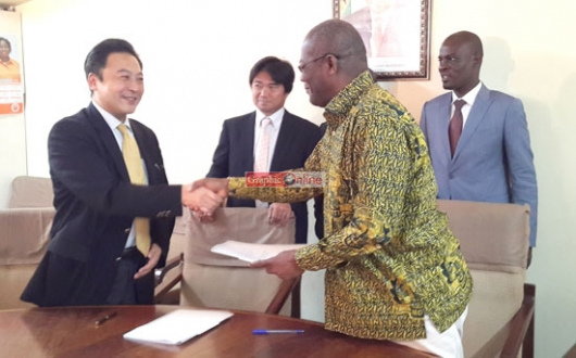 The acting Chief Director of MoTI, Mr Dewarnoba Baekae (right), exchanging the MoU with the Regional Chief Executive Officer for Middle East and Africa for Marubeni Corporation, Mr Masakau Kuramotoe, at a ceremony in Accra.