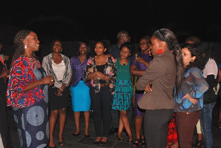 Ms. Esther Cobbah interacting with young women in Africa at Moremi Women's Leadership program