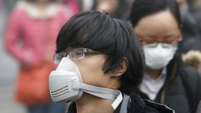 On some days you need a gas mask to go outside due to smog in Beijing