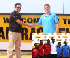 Adeeb (L) in a handshake with Tom. INSET: Appiah in a pose with some of the academy students