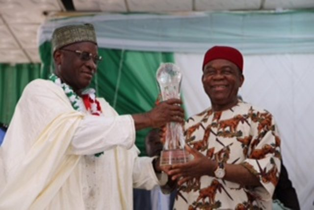 Abia state Governor, Theodore Orji receiving an award as ??Pillar of good governance in Nigeria?? by the National Coalition of good governance (NACOG) from Hon. Justice Alfa Belgore retired Chief Justice of the Federation during the innauguration of the Zonal Cordinators of the group in the south-east in Umuahia.