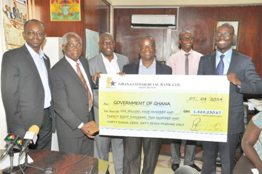 Deputy Minister of Finance (right), Mr Cassiel Ato Forson, with management of GOIL after the dividend payment ?