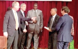 Mr Thibault Langlais ( left), Chairman Total and other board members interact with some shareholders ?