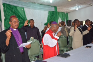 Some of the clergies praying during the solemn assembly organised by the wife of Abia state governor in Umuahia to seek God's intervention for the release of the abducted Chibok school children. DSC-5040- The wife of Abia governor, Lady Nene Ananba, the wife of the Speaker, abia house of assembly, Mrs Vivian Udo Okochukwu and the Commissioner for Women affairs, Mrs nene Nwaejike carrying placards for the release of the abducted Chibok school children during the solemn assembly organised by the wife of Abia state governor in Umuahia to seek God's intervention