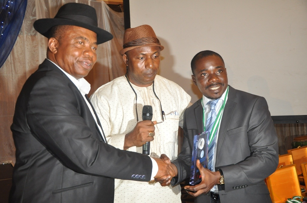 Dr. Dafe Akpocha, Director General, Centre for Democratic Governance in Africa (CDGA); Sir. Henry Muogho, Director of Administration, Ibru Group and Mr. Samuel Ogbogoro, Media Relationship Manager, Dana Air receiving an award on behalf of Dana Air at the global award presentation of Africa Democratic Governance in Lagos