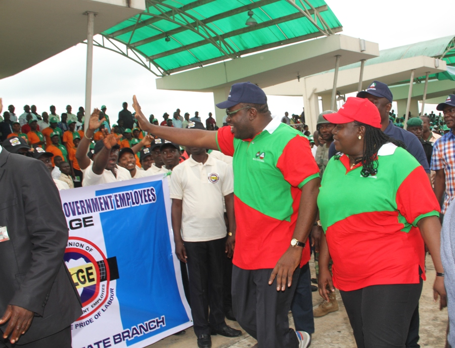 Governor Seriake Dickson of Bayelsa State (2nd R), accompanied by the Chairperson, NLC, Bayelsa State Council, Comr. (Mrs) Ebiuwou Koku-Obiyai (R), acknowledging cheers from workers in the state, during the 2014 May Day Celebration, at the Peace Park, Yenagoa.