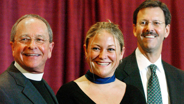 Bishop Gene Robinson, along with his daughter Ella and partner Mark Andrew, attend a news conference after Robinson was confirmed as bishop at the 74th General Convention of the Episcopal Church August 5, 2003, in Minneapolis, Minnesota. ?ERIC MILLER/GETTY IMAGES