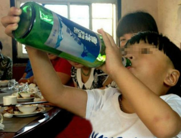Outrage: Two-year-old Cheng Cheng screams for bottles of wine and refuses milk or soft drinks