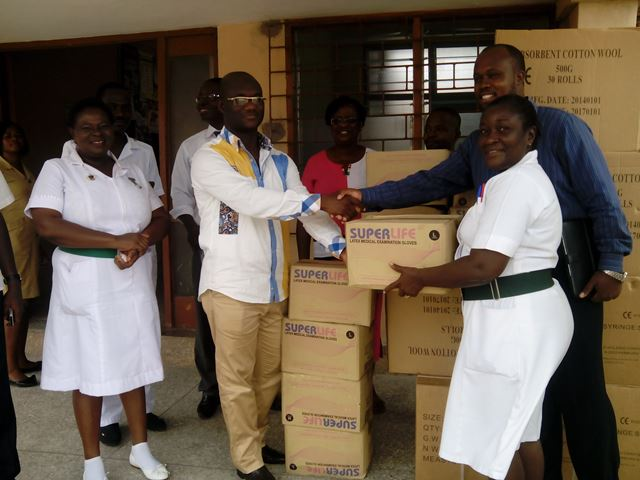 The Executive Director, George K. Odame (left) presenting the items to Matilday Allotey-Anna, Principal Nursing Officer General (right).