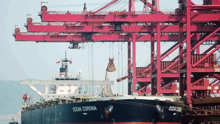 Iron ores are being unloaded at Qingdao port, east China's Shandong province