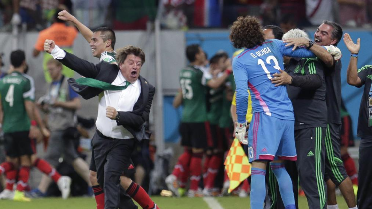 Mexico's head coach Miguel Herrera celebrates after Mexico's Andres Guardado scored his side's second goal during the group A World Cup soccer match between Croatia and Mexico