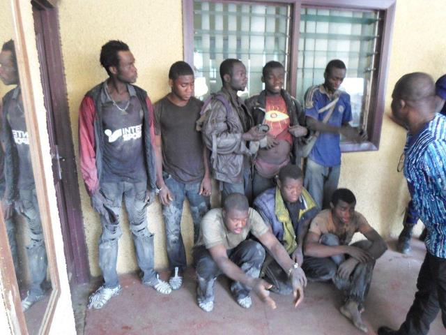 The illegal miners with some of their tools and explosives