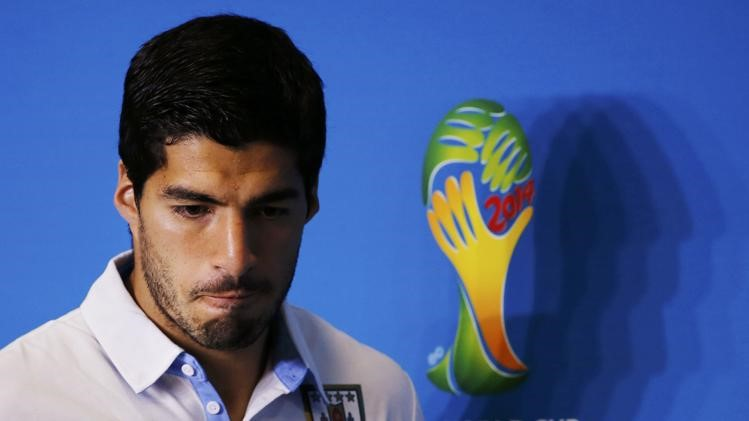 Uruguay's national soccer team player Luis Suarez attends a news conference prior to a training session at the Dunas Arena soccer stadium in Natal ?