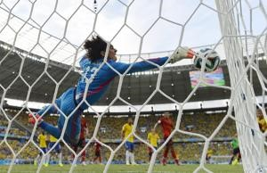 ? ? Mexico's goalkeeper Guillermo Ochoa dives for the ball during the Group A clash against Brazil