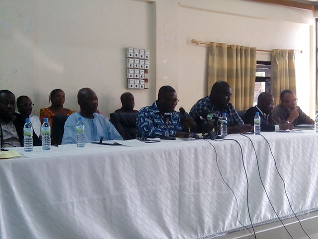 Isaac Bampoe Addo, CLOGSAG Executive Secretary (middle) addressing the media.