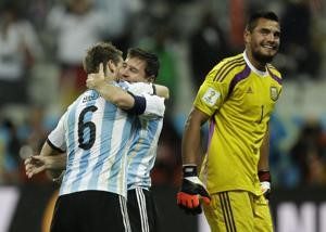 Argentina's Lionel Messi is hugged by Lucas Biglia after Argentina defeated the Netherlands 4-2 ?
