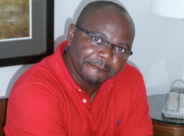 Dr Bob Offei Manteaw in red Lacoste T-shirt.