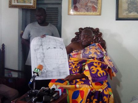 The Paramount chief showing a demarcation map of the Osu traditional council