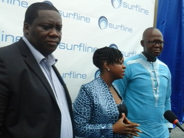 Mrs Rosy Fyn, (middle) Marketing Director of Surfline Communications Limited, and other officials of the company making presentation during the launch.