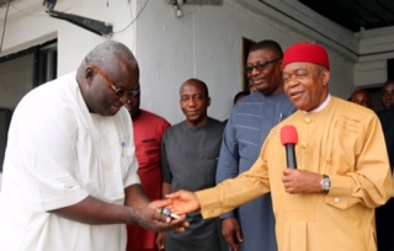 Abia state governor Theodore Orji (right) handing over the > keys to an official vehicle to the president costomary court of appeal > Justice Onwucheka in Umuahia.