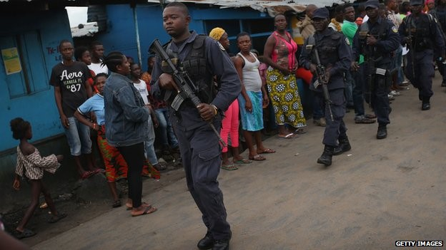 Police fired warning shots but failed to disperse several hundred people around the Ebola centre in Monrovia