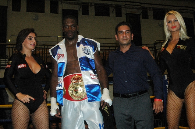 Mark Prince and bout sponsor Baz Rehman flanked by the Spearmint Rhino Ring card girls.