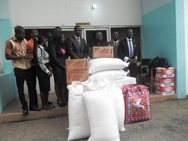 Mr Kofi Osei-Kusi (4th right), OKF Executive President and Dr Pinaman Appau (3rd right), a Psychiatrist at the Accra Psychiatric Hospital, in a group photo during the donation