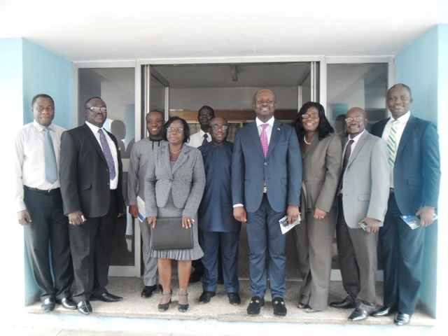 Dr Edward Kofi Omane-Boamah (4th right), Minister of Communications and Dr Bernard Otabil, CEO of the Ghana News Agency (2nd left) in a group photograph during the Minister's visit.