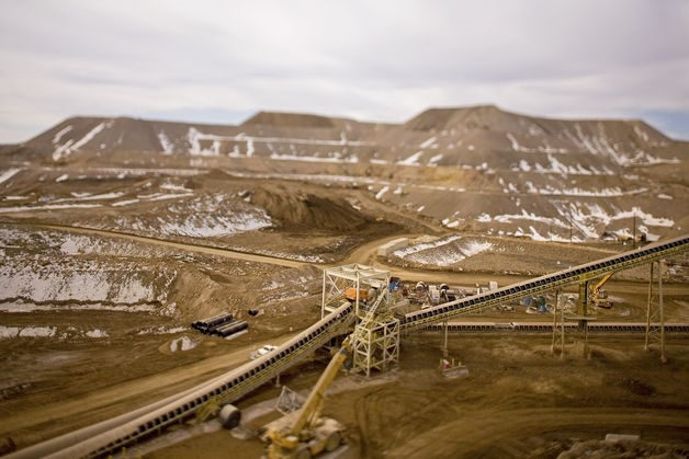A conveyor belt and crusher at the one of Anglogold Mine