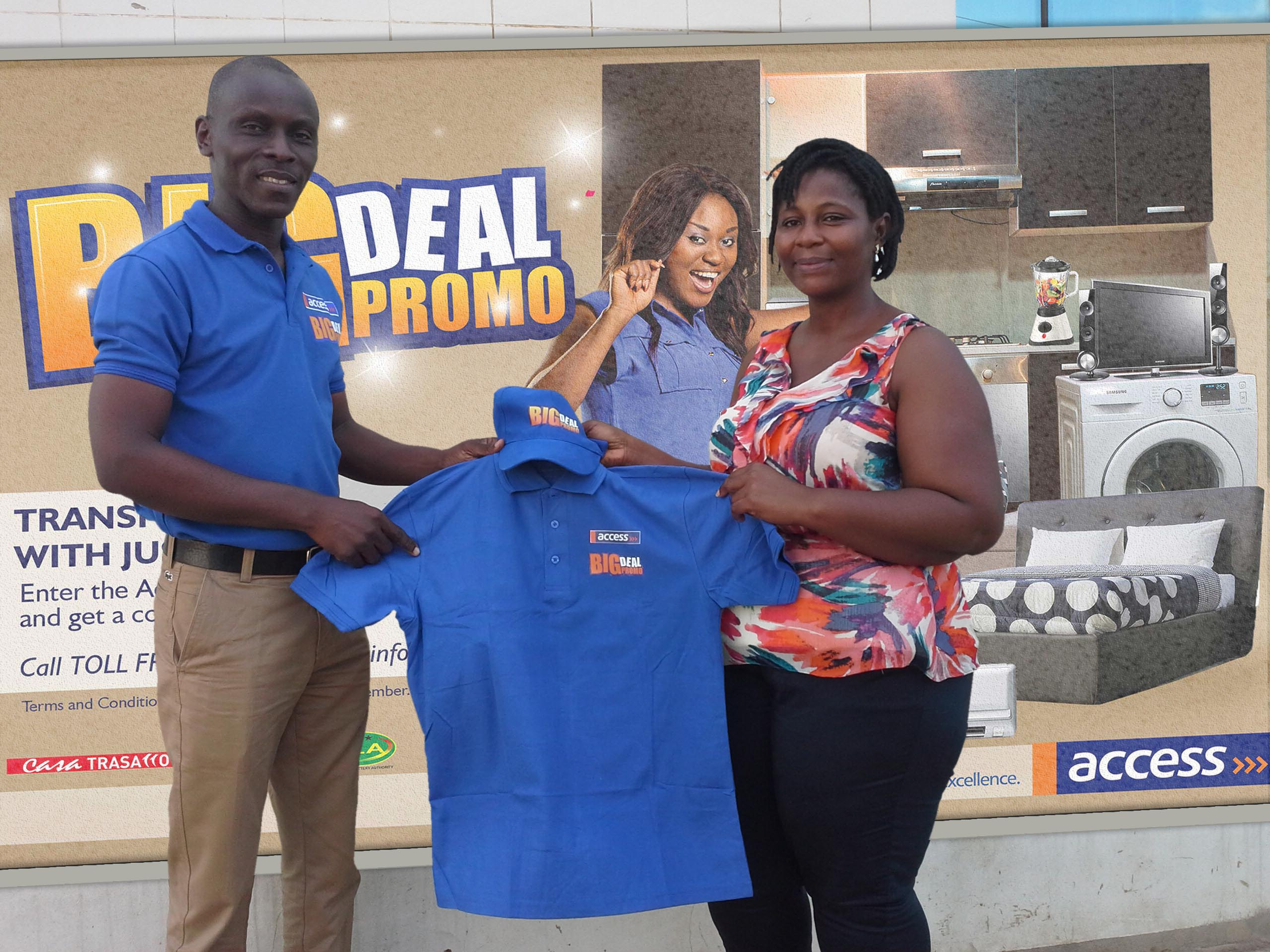 (L-R) Sidney Koranteng, Head of Product Development at Access Bank presenting BIG Deal Promo souvenirs to Miss Nelly Arko-Smith