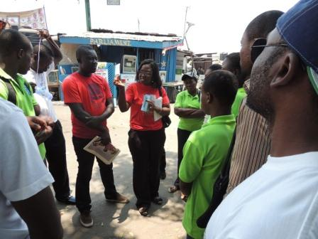 Picture shows an official of the HealthKeepers Network briefing health volunteers at La