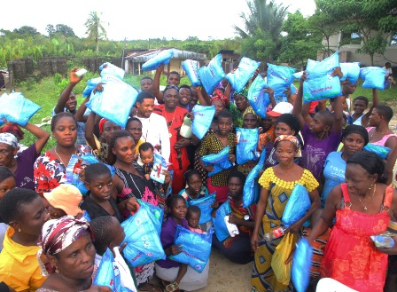 Waconzy donates anti-malaria nets and drugs to residents of riverine areas.