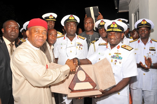 Abia state Governor Theodore Orji receiving a plaque of Excellence from the Chief of Naval Staff, Rear Admr. U O Jibrin after the commissioning of internal roads built by Abia state government at the Nigerian Navy finance and Logistics School, Owerrenta.