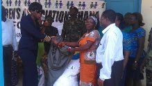 Mrs Kingsley-Nyinah (left), AFCG President presenting the items to Mrs. Victoria Kessie