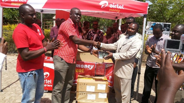 From left Kwame Osafo Amoah Zonal Business Manager -Airtel Ghana in a handshake with Mr. Peter Boate, Acting Upper East Regional Director of Health Services Sector during the presentation