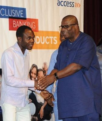 Dolapo Ogundimu in a handshake with one of the bank?s valued customers at the launch event