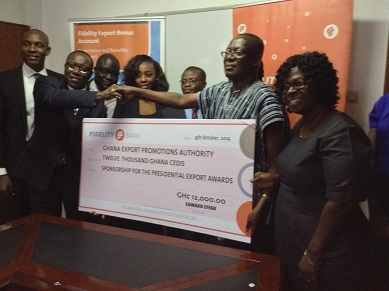 Mr Normeshie receiving the cheque from Mr Dodoo