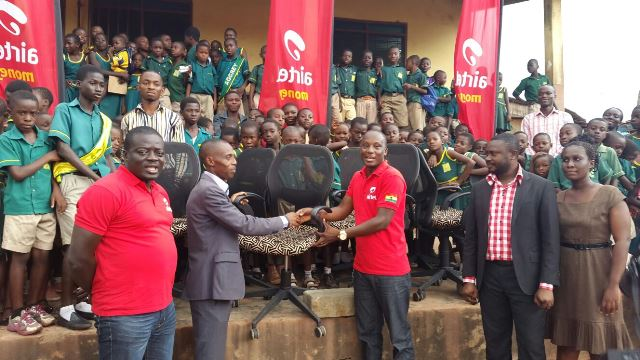Headmaster of school, Mr Wisdom Boamah (left) in a handshake with Airtel Ghana Zonal Business Manager for Central and Western Region, Mr. Emmanuel Osafo (right)