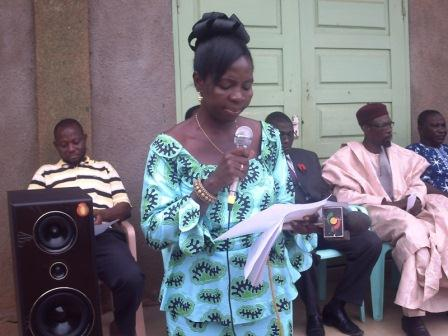 Madam Oku addressing the school children at the opening of the programme.