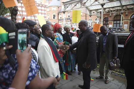 On the President's arrival at the UK, he was met by Ghanaians living and working there.