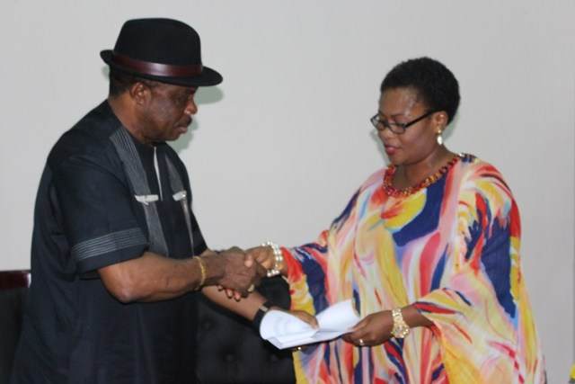 : Chief Willie Obiano receiving a copy of the remarks conveying the commendation from the Anambra State House of Assembly from Princess Chinwe Nwaebili, Speaker, at the Governor's Lodge, Amawbia