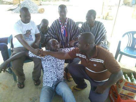 Mr. Simon Salansa Doe (seated left in T-shirt) with some delegates