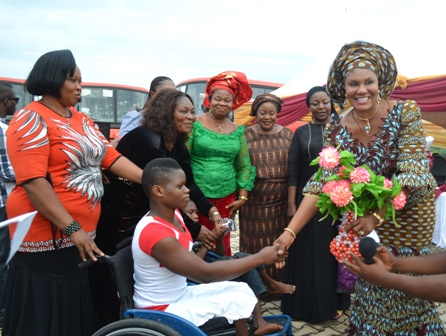 Anambra State First Lady Chief (Mrs.) Ebelechukwu Obiano handing out gifts to the physically challenged at the Governors? lodge Amawbia.