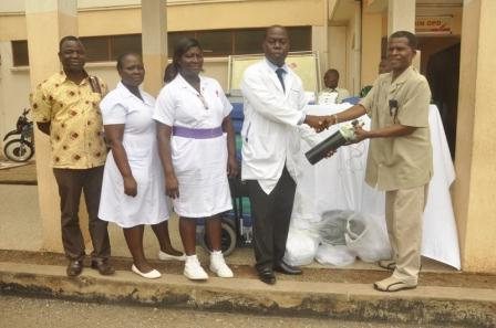 Dr Apori of Ridge receiving medical items from Mr Amarteifio