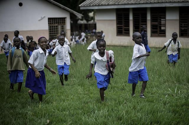 Students of SOS Children?s Village Bangui run out of school at the end of classes