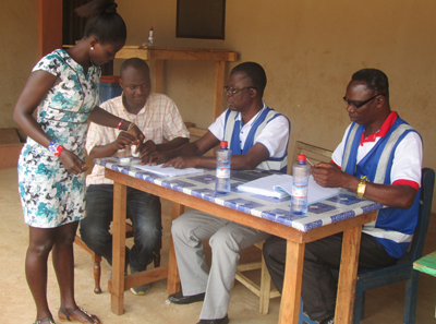 A prospective voter going through the process