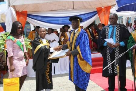 Mr Kukubor Noble Kwabla receiving his award from the Vice Rector of the school.